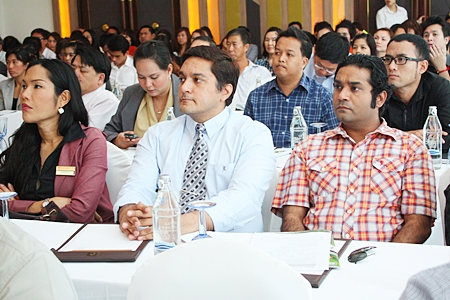 Pattaya Mail GM Kamolthep Malhotra (center) and Massic Travel Manager Vikrom Malhotra listen intently to the presentations at the seminar.