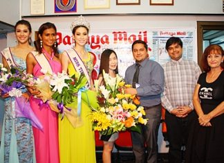 (L to R) 2nd runner-up Siriworakorn Buttayothi, first runner-up Nisha Chaiyapruek, Miss Tiffany Universe 2012 Panwilas Mongkol, and Sarinplus Leelasaowapak, Public Relations Manager for Tiffany's Show Pattaya Co., Ltd., recently visited the Pattaya Mail offices, where they presented flowers to thank General Manager Kamolthep Malhotra, Deputy Managing Director Suwanthep Malhotra, and Pattaya Blatt Executive Editor Elfi Seitz.