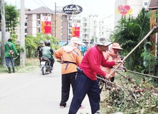 Sanitation workers clean sois and alleys around Pattaya.