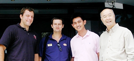 Mechai on the right, poses with staff Nut, Michael, and Tristan (left) of the Mechai Pattana School.