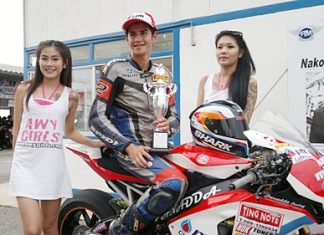 Benn Fortt, center, poses with his trophy after winning the second round of the SB2 Superbike 1000cc Thailand Championship at Nakon Chaise racetrack.