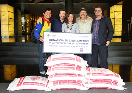 (L to R) Pattaya Musicians 4 Charity members Lian Thonginn, JD Eisenberg (guitarist), Kanjana Ngamkalong (Hard Rock marketing communications manager), Tom Rossetti (chairman) and Les Deshane (guitarist) are all smiles at the donation.