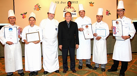 GM Chatchawal Supachayanont (centre) and Executive Chef Adrian W. O'Herlihy (3rd left) stand proudly with the Kitchen Team of Dusit Thani Pattaya who received certificates of commendation at the Thailand Ultimate Chefs Challenge 2012 held in Bangkok recently. The event was held to promote and recognize the skills and talents of professional chefs in Thailand. (L to R) Srithon Pongham, Chef de Partie (Patisserie); Khanatsanan Wangsa, Commis II (Patisserie); Chef Adrian, Chatchawal Supachayanont; Somchai Kumpoo, Demi-Chef de Partie (Gardemanger) and Narong Chawicha (Chef Pâtissier). The kitchen talents took home the silver and bronze awards from the Fruit Carving and Ice Carving categories as well as Western Plated Desserts and Freestyle Showpiece challenges.