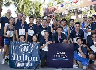 Harald Feurstein (standing left), GM of the Hilton Pattaya led his team of athletes to compete in the King's Cup Pattaya Marathon 2012 recently. The annual event saw more than 10,000 runners and walkers compete this international competition.