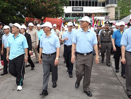 Government officers, police, soldiers, private and public sectors march in the anti-drug parade.