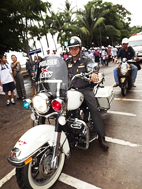 Pol. Col. Somnuk Changate leads the big bike parade.
