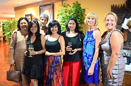 The women gather for a commemorative group photo (L to R) Alvi Sinthuvanik, Chitra Chandrasiri, Pat Burbridge, Sue Kukarja, Malwinder Malhotra, Judy Hoppe and Rosanne Diamente.