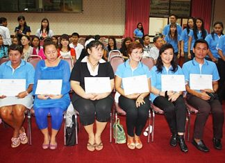 Local folks who passed the foreign language program wait to accept their certificates.
