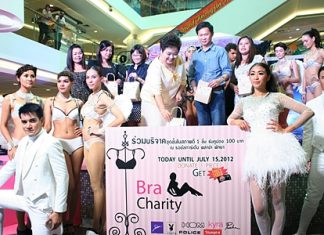 Sailom Wongsasulak (center, yellow dress), president of the Fight Against AIDS Foundation, donates undergarments to the cause.