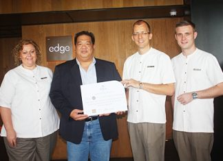Hilton Pattaya General Manager Harald Feurstein (2nd right) presents the prize to winner Anucha Pingkarawat (2nd left) as Peta Ruiter (left), Hilton's director of business development and Simon Bender (right), food and beverage manager look on.