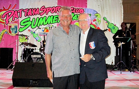 Lucky draw prize winner Ken Bernek, left, stands with PSC President Tony Oakes, right.