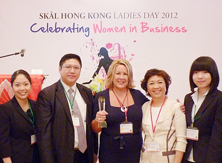 "Susan Field (center) is named Skål Hong Kong's ""Business Leader of the Year""."