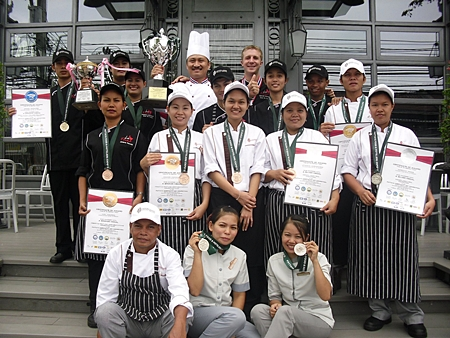 "The Culinary & Housekeeping team of Woodlands Hotel & Resort Pattaya proudly show off their numerous awards that they won in the Food & Spa categories at the ""Pattaya Food & Hotelier Expo 2012"" held in Pattaya recently. The Woodlands team claim their victories were the result of great team spirit and relentless efforts to be the best."