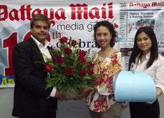 Tony Malhotra, Asst. MD of the Pattaya Mail Media Group receives a bouquet from Usa Pookpant, PR manager and Wirasinee Kaewkeeree, PR executive of Centara Grand Mirage Beach Resort Pattaya to congratulate us on our recent 19th anniversary.