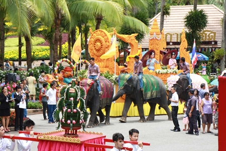 Elephants and a giant candle are centerpieces at the Nong Nooch Tropical Gardens parade.