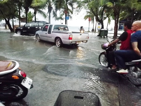 A monsoon flooded Beach Road making it impossible to form and march in a parade.