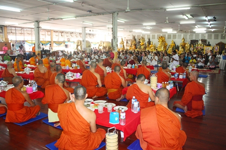 Residents offer lunch to more than 50 monks at Jittapawan Temple.
