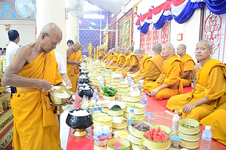 Revered monks prepare for the Khao Pansaa festivities at Wat Thamsamakhee.