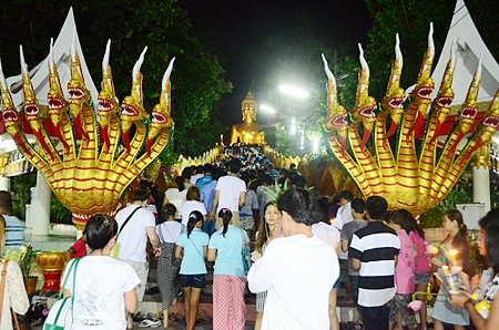 Thousands of people take part in the Wien Thien ceremony at Wat Phra Yai.