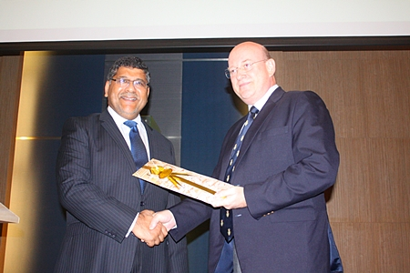 Former BCCT Chairman Graham Macdonald (right) presents a gift to the departing British Ambassador to Thailand HE Asif Ahmad.