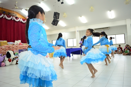 Young girls perform a beautiful dance.