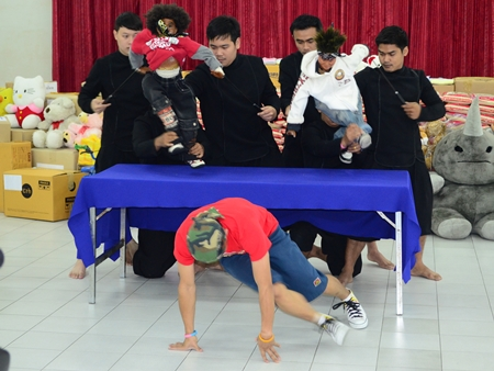 The puppet troupe does a break dance for the party.