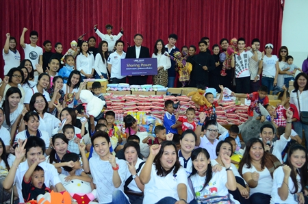 Fr. Michael Weera Phangrak (center), executive director of the orphanage, accepts donations from Piya Rattanaburee, manager of customers relations, and Sukhrudee Pongpanwattana, director of creative and corporation communications, with the committee from King Power Co. Ltd., and the performers, care givers and children.