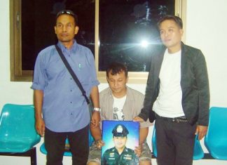 Police held suspect Sethawuth Phanusithidechanont (seated) long enough to take this photo, but lost him later from Banglamung Hospital.