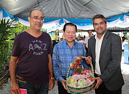 "Korn Kij-amorn (left), Pattaya Mail office manager and Suwanthep ""Tony"" Malhotra (right), Pattaya Mail's deputy managing director, wish Sansak Ngampichet a happy 71st birthday."