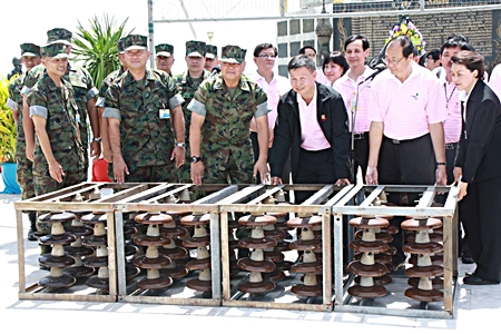 EGAT officials and top Navy brass announce the handover of electrical parts designated to be used to form an artificial coral reefs.