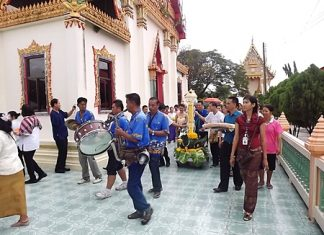 The Diana Group and members of the Press Association of Pattaya celebrate the start of Buddhist Lent by offering candles and supplies to monks at local temples.