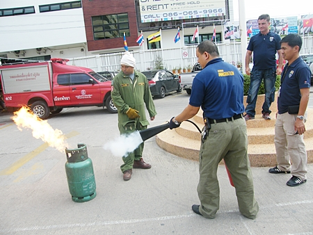 Immigration officials are given realistic hands on training in basic fire-fighting techniques using extinguishers.