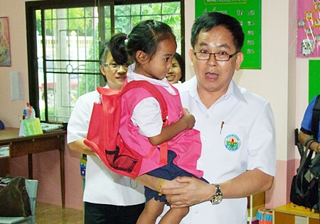 Dr. Pornthep Siriwanarangsun, director-general of Thailand's Disease Prevention and Control Department, visits the Khao Maikaew children's center to give administrators tips on preventing the spread of Hand, Foot and Mouth disease.