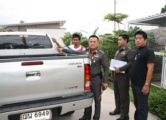Wuthipan Krajuikrajai (left) shows Pol. Col. Somnuk Changate and other police officials damage done to his pickup from the late night barrage of gunfire.