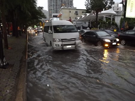 Hours after the rain had stopped, Beach Road was still flooded.