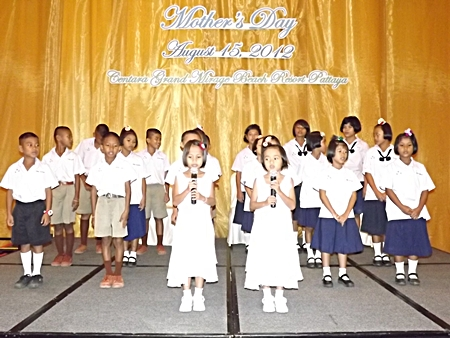 Children from the Father Ray Foundation sing for the guests.