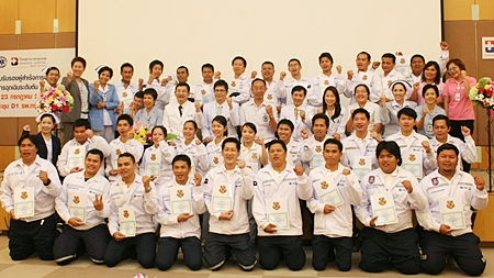 All 33 successful trainees of the Emergency Medical Technician-Basic Curriculum pose for a class photo with instructors and organizers.