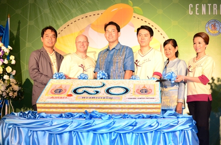 (L-r) Pairoj Boonjun, GM of Central Center Pattaya; David Cumming Amari's Area GM, Pattaya; Mayor Itthiphol Kunplome; Poramet Ngampichet, Chonburi MP; Jintana Maensurin Pattaya education department director and Praichit Jetapai, Chairwoman of Y.W.C.A. Bangkok-Pattaya Center join together to officially open the ceremony.