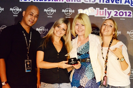 Ian Sutedjo (left) (director of sales and marketing for Hard Rock Hotel Pattaya) and Svetlana Katorgina (right - senior sales manager for Russia & C.I.S. for Hard Rock Hotel Pattaya) present a thank you award to Russian tours guides Lyria and Tatyana from Russian tour company Biblio Globus.