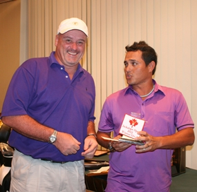 Division 1 winner Doug Lynch, left, receives his prize.