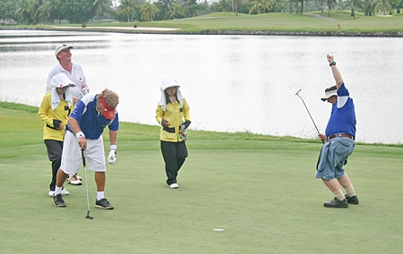 Celebrations on the green – another putt drops.