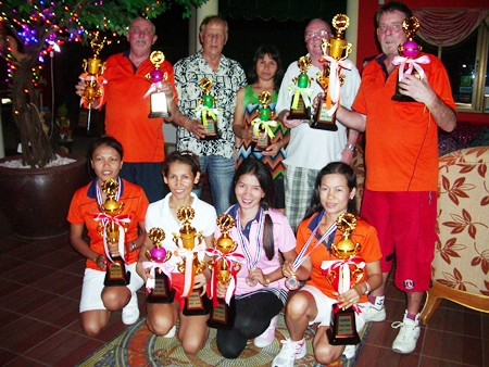 July league winners with their trophies.