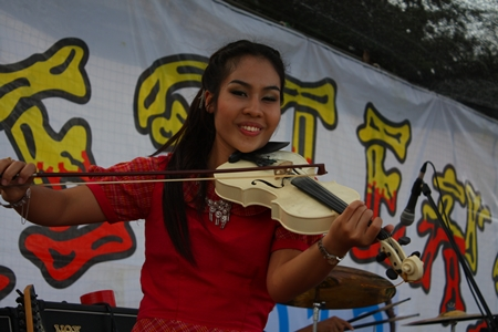 Pukpik entertains the crowd with her magical violin.