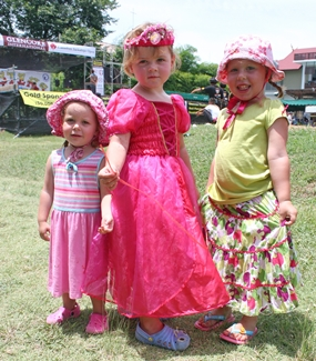 Three young princesses dress in their Sunday best.
