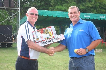 Simon collects his luck draw winnings from Tony.