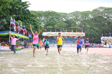Theerangkanul Naiyathet from Pattaya School No. 11 wins the 100 meter Under-14 male race with a time of 12. 49 seconds.