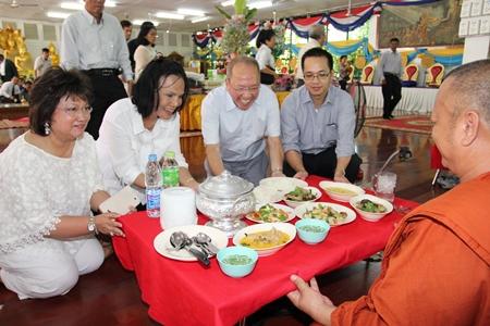 (L to R) Janthra Chainam, Srisai Suchatwuthi, Dusit Thani Hotel Pattaya GM Chatchawan Supachayanont, and Ornop Supachayanont present alms to Provost Sangkharatpongsak Wuthiyano, director of Jittapawan College.