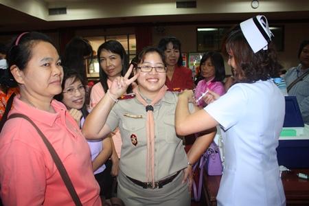 Nattajira Kawinpopchutisiri shows how a temporary little pinch now is worth not suffering the flu later.