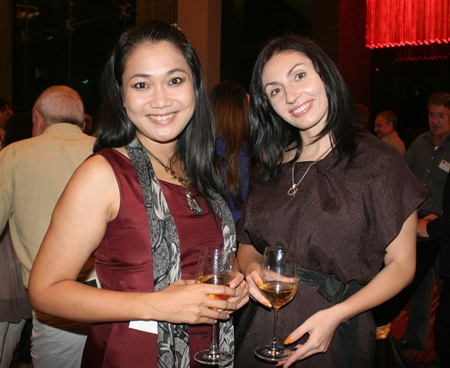 Karnsinee Lertrattanasan and Irena De Ribas brighten the night with their smiles.