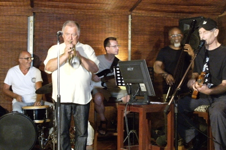 International artists (left to right) Peter Couling on drums, Paul Erik on trumpet, Michael Sternbacher on guitar, Jair-Rohm Parker Wells on bass, and Thomas Reimber on guitar - synthesizer, jamming the night away at the Jazz Pit on Soi 5.